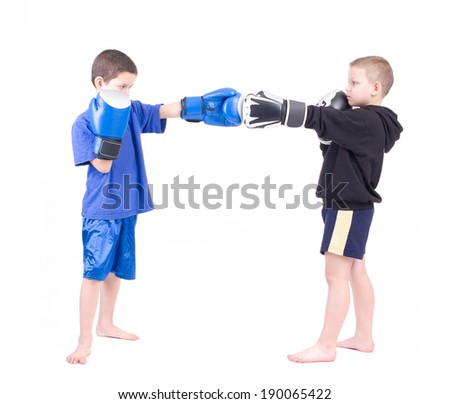 Two kids sparring. Isolated on a white background. Studio shot - stock photo