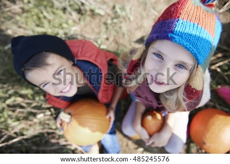 Two kids with Halloween pumpkins