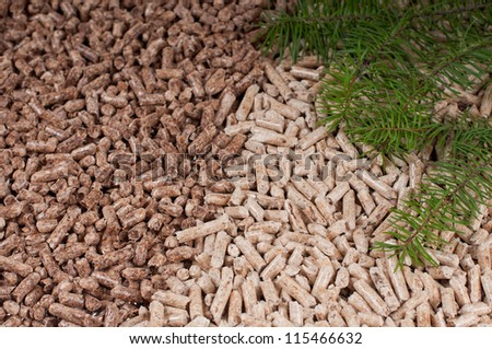 Two kind of pellets and materilas pellets made- selective focuson the front - stock photo