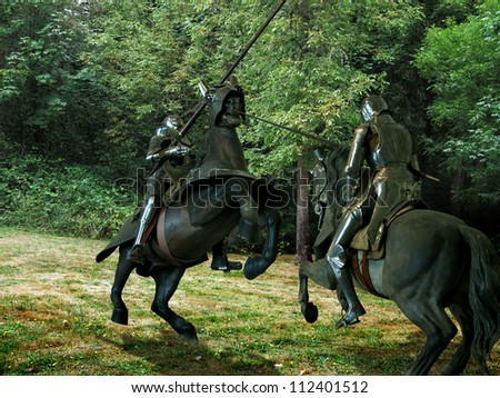 Two knights jousting, on horseback, against the woods - stock photo