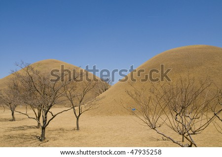 Two Korean burial mounds (Dolmen) from the ancient Silla kingdom. - stock photo