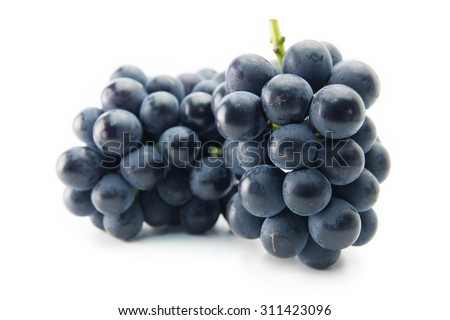 Two Kyoho grapes (giant mountain grapes) upright, isolated on white. One in front and other in background. - stock photo