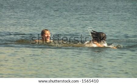 two lads bathe - stock photo