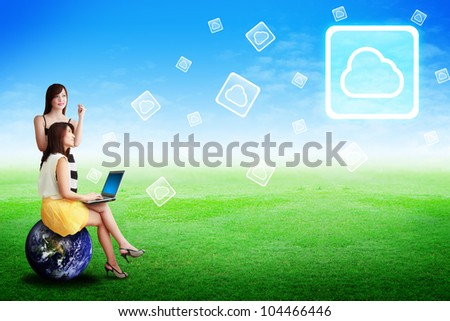 Two lady look at the Cloud computing icon : Elements of this image furnished by NASA - stock photo
