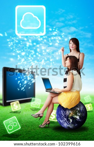 Two lady look at the Cloud computing icon from tablet computer : Elements of this image furnished by NASA - stock photo