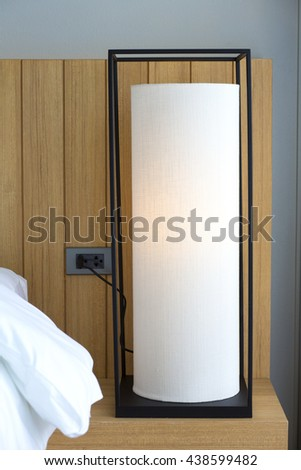 Two lamps in bedroom - stock photo