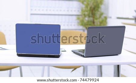 Two laptop on a table at office - stock photo