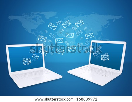Two laptops exchange letters. The concept of e-mailing - stock photo