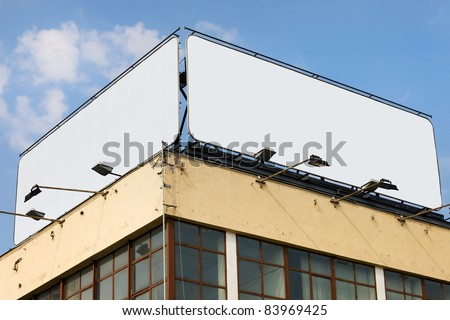 Two large blank billboards with copy space on a building roof - stock photo