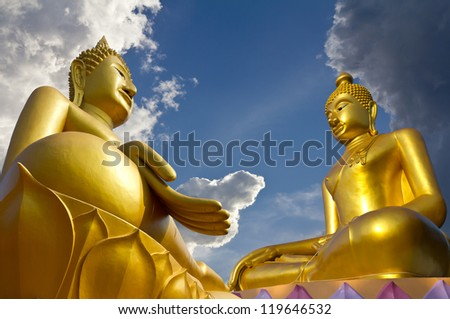 Two large statues of Buddha pagoda concentrate on clouds and sky. - stock photo