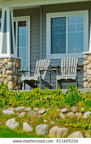 Two lawn chairs at the house patio at front yard. Landscape design. - stock photo