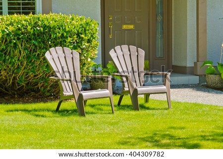 Two Lawn Chairs At The Nicely Trimmed Front ( Back ) Yard. Landscape Design.