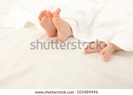 Two legs of Asian infants - stock photo