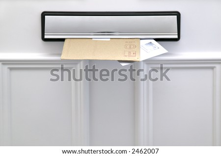 Two letters sticking out of a letterbox on a white door, space for copy - stock photo