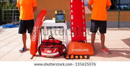 Two Lifeguards with their equipment. - stock photo