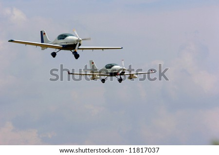 Two light aircrafts during a flight sport show ready for landing - stock photo
