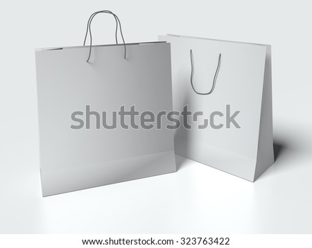 Two light gray paper bags with handles on white background. mock up - stock photo