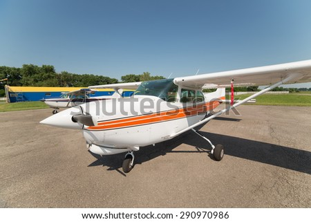 Two light planes parked on the private airfield - stock photo