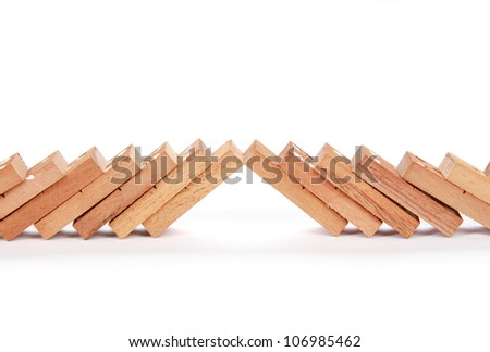 two lines of dominoes clashes on white background - stock photo