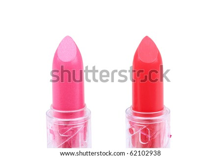 Two lipsticks on white, closed-up - stock photo