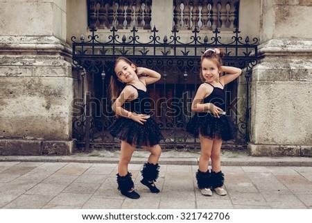 Two little ballerinas dansing in black tutu - stock photo