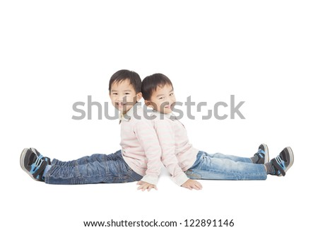 two little boy sitting on the floor - stock photo