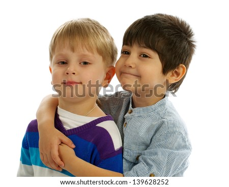 Two Little Boys Embraces and Smiling