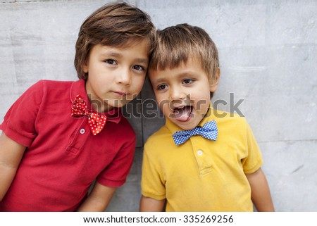 two little boys with bow tie