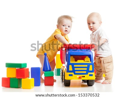 two little children play with block toys - stock photo