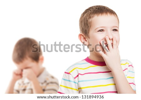 Two little displeased child boy brothers in family conflict quarrel - stock photo