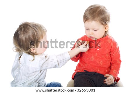 two little funny girls on white background