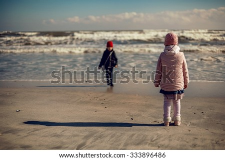 Two little girl playing and waiting for the summer - stock photo