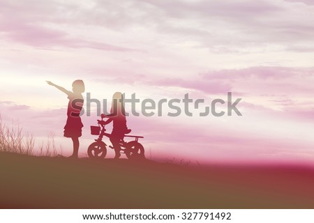 two little girls bike silhouette