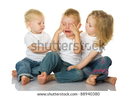 Two little girls calm the crying boy. isolated on the white background - stock photo
