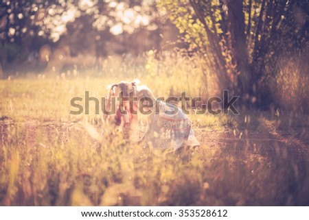 Two little girls enjoying the great outdoors - stock photo
