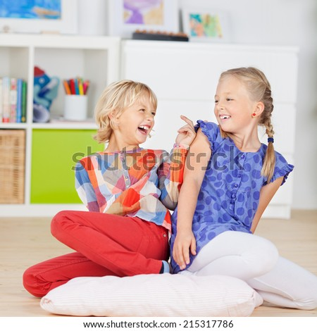 Two Little Girls having fun at home
