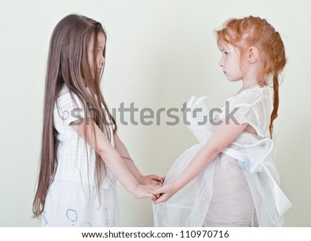 Two little girls holding hands. Girlfriend. - stock photo