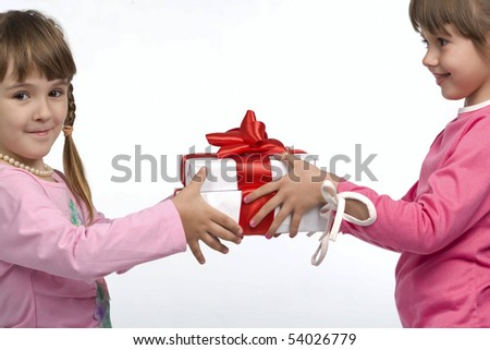 Two little girls holding white gift boxes - stock photo