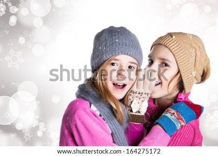 Two little girls in Christmas background - stock photo