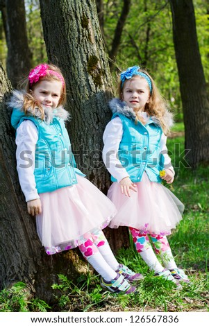 two little girls in park in the spring - stock photo