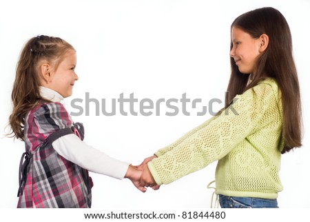 two little girls on a white background - stock photo