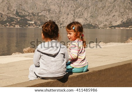 Two little girls on the coast
