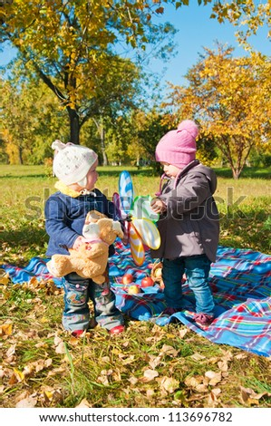 two little girls on walk in park in the autumn - stock photo