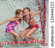 two little girls playing in the waterpark - stock photo