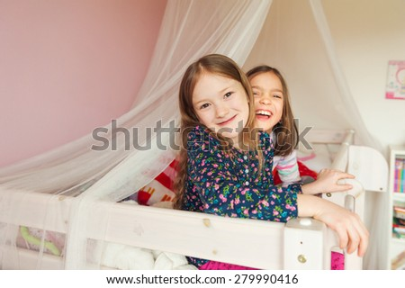 Two little girls playing in their room - stock photo