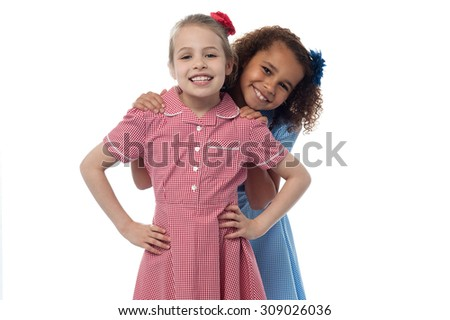 Two little girls showing their affection - stock photo