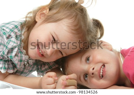 two little girls with a beautiful smile - stock photo