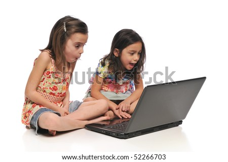 Two little girls with a laptop computer isolated on a white background