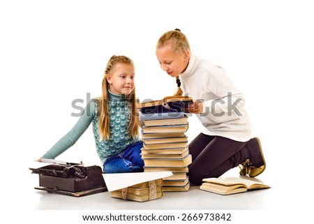 two little girls with a lot of books isolated on a white background - stock photo