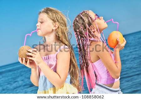 two little girls with fruit - stock photo